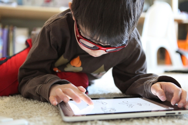 Young boy with tablet device